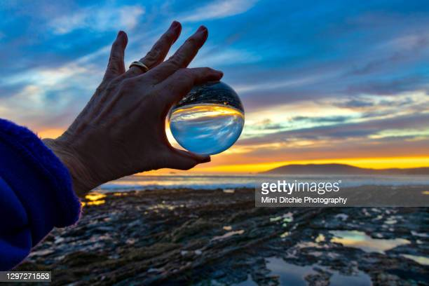 shell beach sunset in a glass sphere - pismo beach stock pictures, royalty-free photos & images