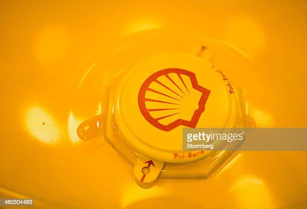 A Shell branded TriSure tabseal barrel cap sits on a filled oil drum at Royal Dutch Shell Plc's lubricants blending plant in Torzhok Russia on Friday...