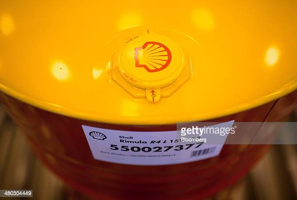 A Shell branded TriSure tabseal barrel cap sits on an oil drum filled with Rimula heavyduty engine oil at Royal Dutch Shell Plc's lubricants blending...