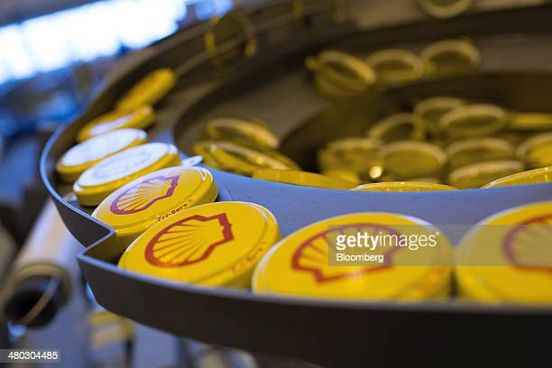 Shell branded TriSure tabseal barrel caps are sorted ahead of fitting to oil drums at Royal Dutch Shell Plc's lubricants blending plant in Torzhok...
