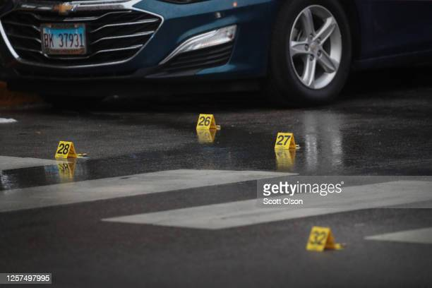 Shell casing markers litter the ground as police investigate the scene of a shooting in the Auburn Gresham neighborhood on July 21, 2020 in Chicago,...
