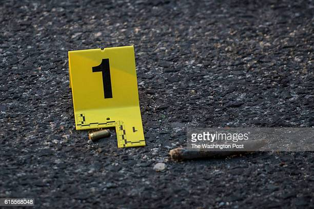 A shell casings lay in the street as officers investigate on K Street after a man allegedly fired a gun in between 13th and 14th Streets in...