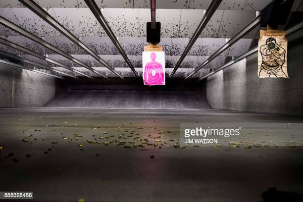 Shell casings litter the floor of the indoor gun range at Blue Ridge Arsenal in Chantilly Virginia on October 6 2017 / AFP PHOTO / JIM WATSON