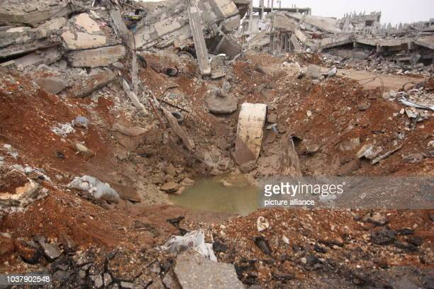 A shell crater in Kobane Syria 30 January 2015 The Kurds have recaptured the city though the price is very high The extremists' heavy artillery the...
