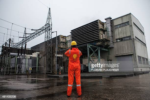 Shell employee at the Afam VI power plant takes a picture at the plant in Port Harcourt on September 29, 2015. Afam VI power plant is owned by the...