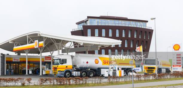 shell fuel delivery trucks supplying a gas station with fuel - shell brand name stock pictures, royalty-free photos & images