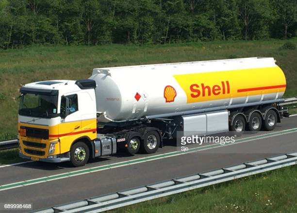 shell fuel deliviry truck driving on the road - shell brand name stock pictures, royalty-free photos & images
