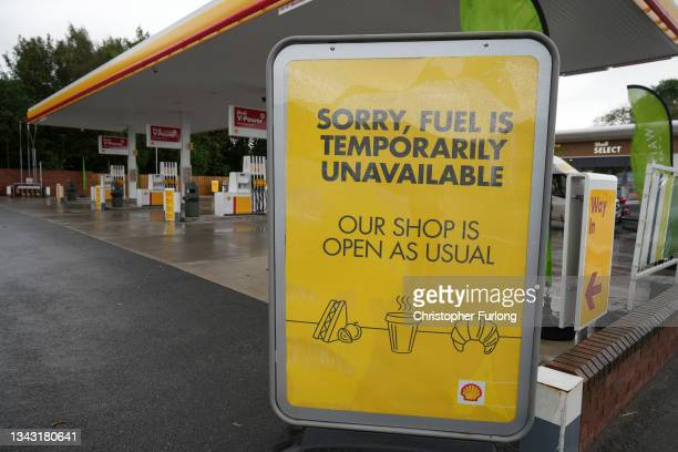 Shell garage advises customers that fuel is temporary unavailable on September 27, 2021 in Northwich, United Kingdom. The British government will...