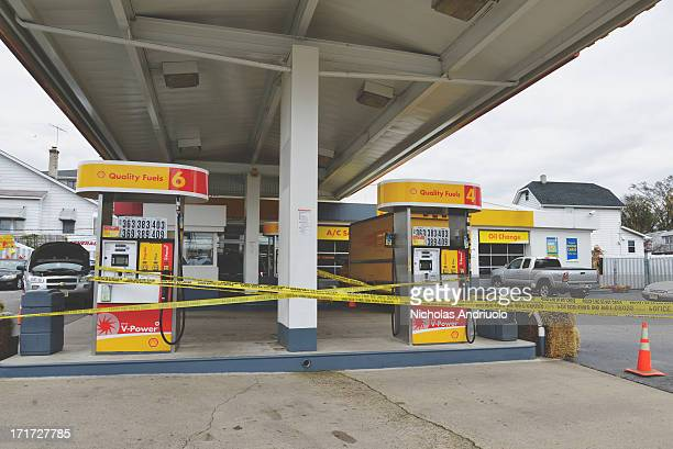 Shell gas station has been covered in police tape to deter gas hunters from trying to line up after Hurricane Sandy The station had run out of fuel...