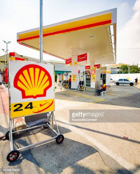 shell gas station in bangkok thailand - shell brand name stock pictures, royalty-free photos & images