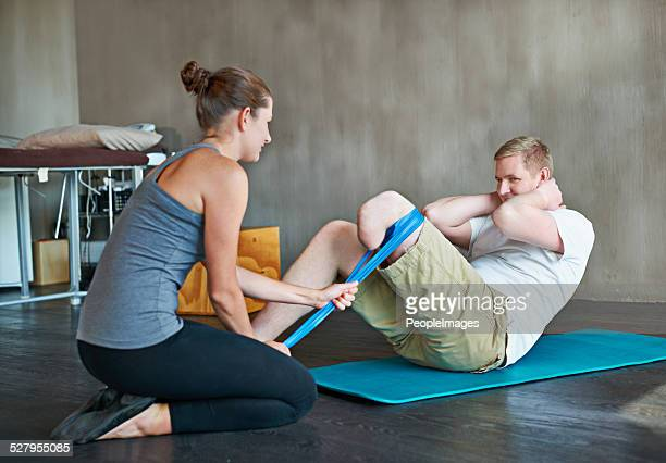she'll get him back to 100% - paraplegic stock photos and pictures