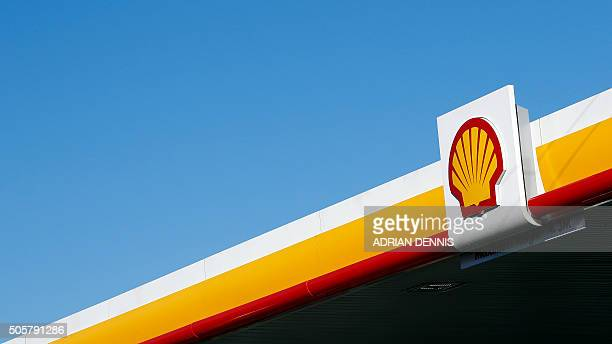 Shell logo is pictured outside a Royal Dutch Shell petrol station in Hook, near Basingstoke on January 20, 2016. Royal Dutch Shell said it expected a...