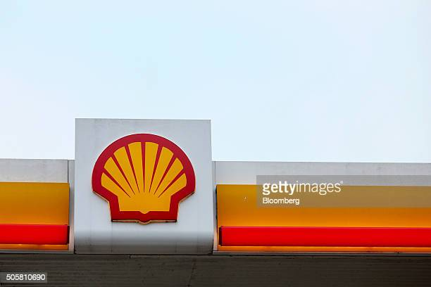 A Shell logo sits on a sign outside a Royal Dutch Shell Plc gas station in Brentwood UK on Wednesday Jan 20 2016 Shell which is buying BG Group Plc...