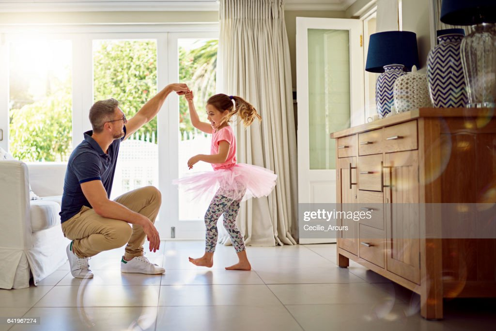 She'll never forget the day he taught her to dance : Stock Photo