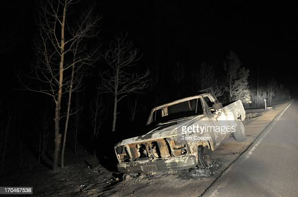 A shell of an automobile destroyed in a fire that's been burning since Tuesday near Colorado Springs sits by the side of the road June 13 2013 in...
