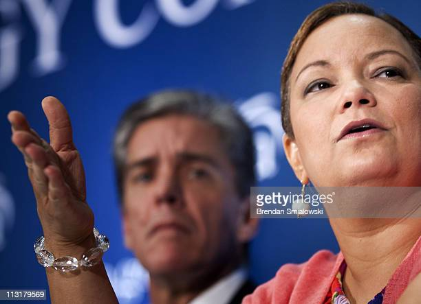 Shell Oil President and Director Marvin Odum listens while Environmental Protection Agency Administrator Lisa P Jackson speaks during a plenary...