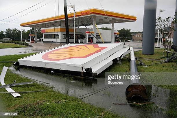 Shell Oil station's sign lies on the sidewalk after being knocked down by the winds of Hurricane Rita early Saturday September 24 in Chambers County...