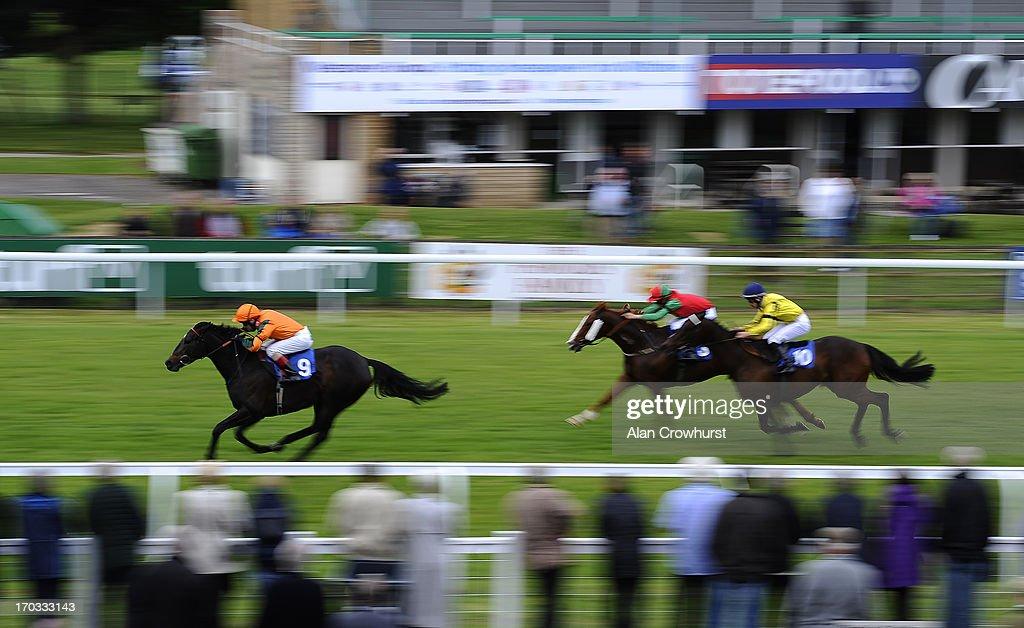 Shelley Birkett riding Maria Montez win The CGA Racing Excellence Apprentice Handicap Stakes at Salisbury racecourse on June 11, 2013 in Salisbury, England.