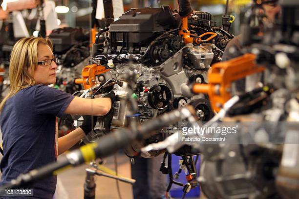 Shelley Catari assembles engine components for a Chrysler Minivan on the assembly line at the Chrysler Windsor Assembly plant January 18 2011 in...