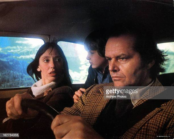 Shelley Duvall Danny Lloyd and Jack Nicholson in car on their way to resort in lobby card for the film 'The Shining' 1980