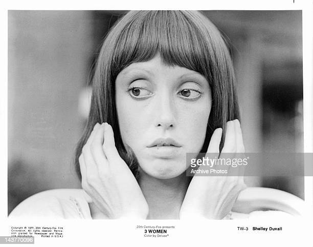 Shelley Duvall with hands to hair in a scene from the film '3 Women', 1977.