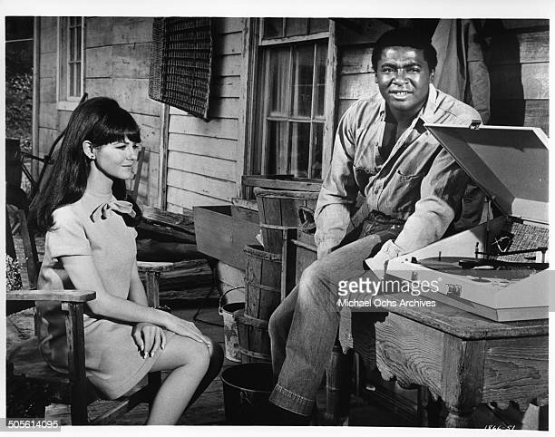 Shelley Fabares and D'Urville Martin listen to the first smash hit record of their friend in a scene from the movie A Time to Sing circa 1968