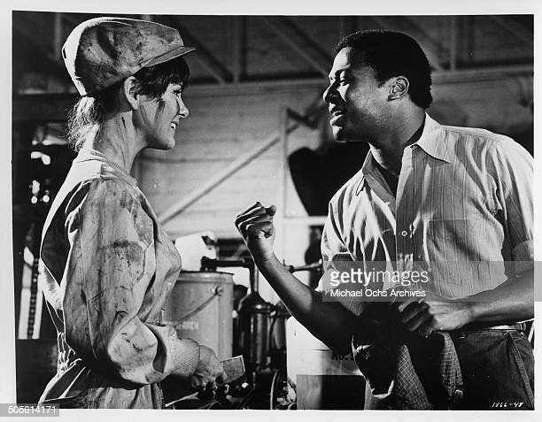 Shelley Fabares listens to D'Urville Martin in a scene from the movie A Time to Sing circa 1968