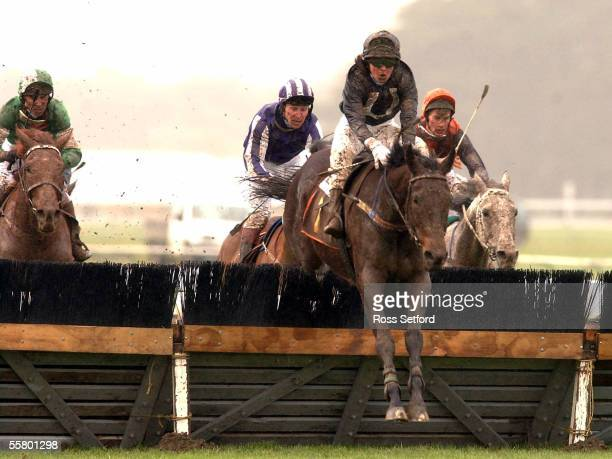 Shelley Houston rides Super Dupa over the last hurdle on their way to winning the Angus Inn Hurdle at the Wellington Racing Clubs winter meeting,...