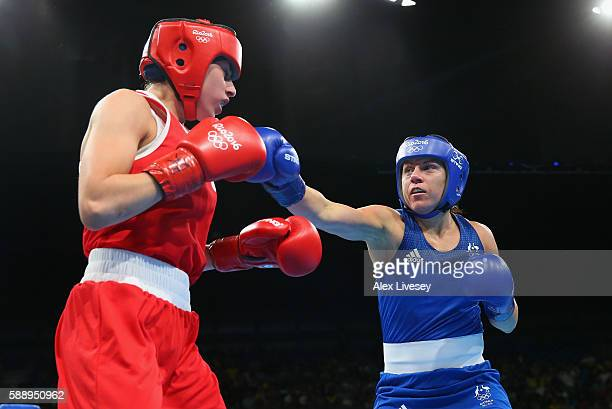 Shelley Marie Watts of Australia lands a right shot on Irma Testa during the Women's Lightweight Preliminaries bout on Day 7 of the 2016 Rio Olympics...