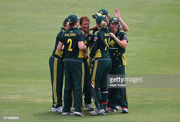 Shelley Nitschke of Australia celebrates with her team mates after taking a wicket during the first Women's Twenty20 match between Australia and...