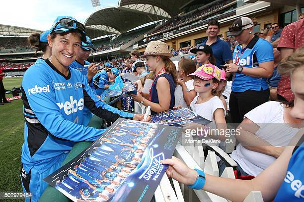 Shelley Nitschke of the Adelaide Strikers signs posters for spectators after the Women's Big Bash League match between the Adelaide Strikers and the...