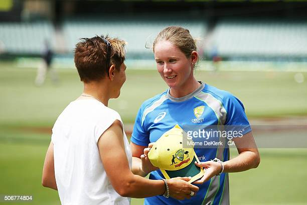 Shelley Nitschke presents Beth Mooney with her Australian cap before the women's Twenty20 International match between Australia and India at Adelaide...
