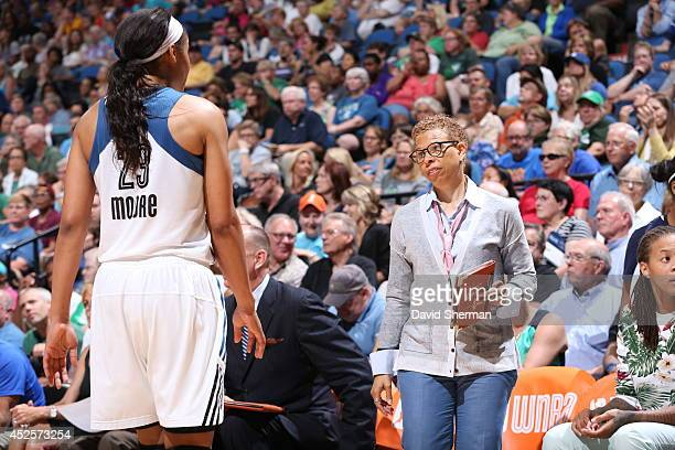 Shelley Patterson assistant coach of the Minnesota Lynx talks with Maya Moore during the WNBA game against the Atlanta Dream on July 22 2014 at...