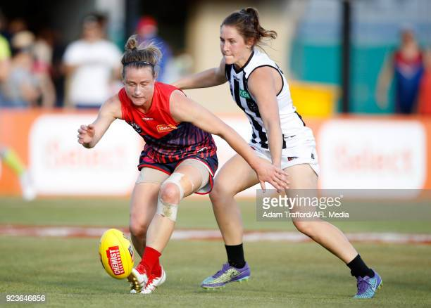 Shelley Scott of the Demons is tackled by Iilish Ross of the Magpies during the 2018 AFLW Round 04 match between the Melbourne Demons and the...