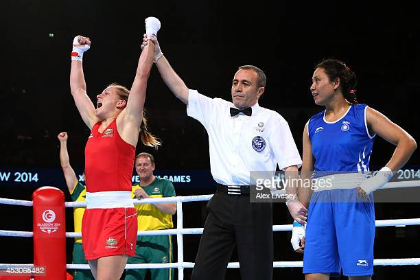 Shelley Watts of Australia celebrates winning the gold medal against Laishram Devi of India in the Women's Light Final at SSE Hydro during day ten of...