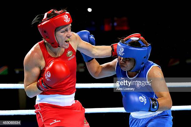 Shelley Watts of Australia competes against Laishram Devi of India in the Women's Light Final at SSE Hydro during day ten of the Glasgow 2014...
