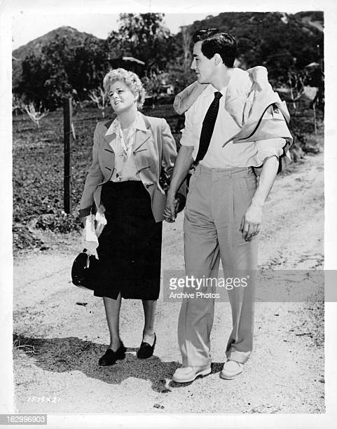 Shelley Winters walks with Vittorio Gassman after a day of shooting the film 'My Man And I' 1952