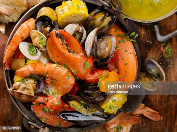 shellfish bake with vegetables - clams stock photos and pictures
