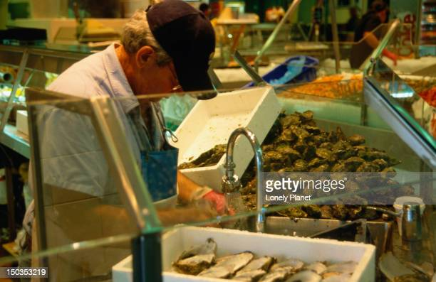 Shelling oysters at a stall in the Sydney Fish Market