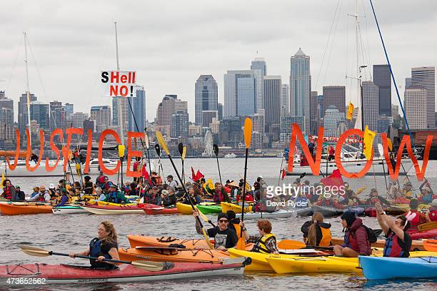 ShellNo flotilla participants hold signs during demonstrations against Royal Dutch Shell on May 16 2015 in Seattle Washington On Saturday...