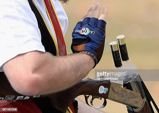 Shells are ejected from a shotgun during Day 3 of the Rio 2016 Olympic Games at the Olympic Shooting Centre on August 8 2016 in Rio de Janeiro Brazil