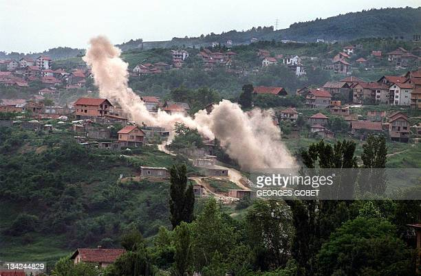 Shells hit houses in the suburbs of Sarajevo on June 6, 1992. Heavy shelling and fighting raged throughout the Bosnian capital overnight after a UN...