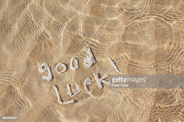shells spelling 'good luck' in sea