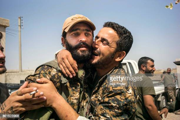 Shellshocked MFS soldier is greeted as he returns back from fighting ISIS on August 16, 2017 on the western front lines of Raqqa, Syria. The MFS is a...