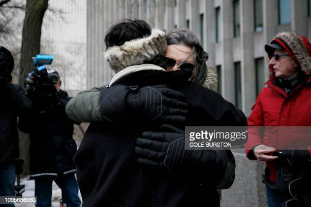 Shelly Kinsman is embraced by supporter Susan Gapka as she leaves The Toronto Courthouse in Toronto Ontario on Friday February 8 2019 after the...