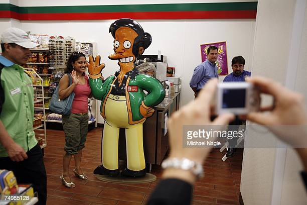Shelly Ramsammy poses with a representation of 'Apu' fictional owner of the KwikEMart from the longrunning televsion cartoon show 'The Simpsons' at...