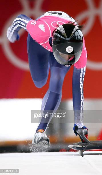 Shelly Rudman of Great Britain jumps onto her sled during official training for the women's skeleton 15 February 2006 in Cesana Pairol at the Turin...