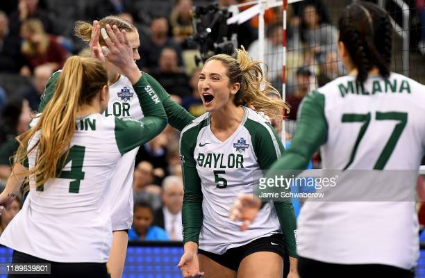 Shelly Stafford of the Baylor Bears reacts after a point in the match against the Wisconsin Badgers during the Division I Women's Volleyball...