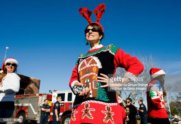 Shelly Stately center organizer of the 2nd Annual Ugly Christmas Sweater Bike Ride keeps an eye out for bikers wearing ugly Christmas sweaters at the...