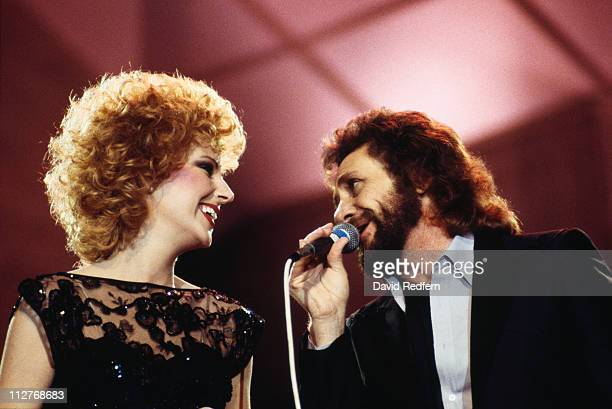 Shelly West US country music singer peforming a duet with US country music singer David Frizzell in a live concert performance circa 1984